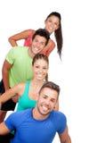 Amigos felices con la ropa de deportes coloreada Fotografía de archivo libre de regalías