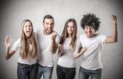 Amigos felizes Cheering Imagens de Stock Royalty Free