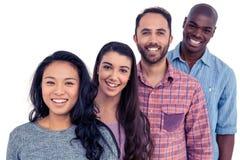 amigos Multi-étnicos que se colocan en línea fotos de archivo libres de regalías