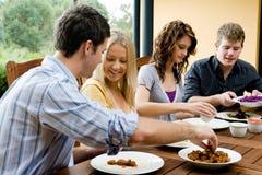 Amigos que cenan Imágenes de archivo libres de regalías