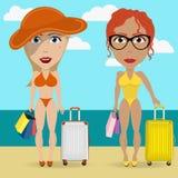 Amigos que se relajan en la playa Imagen de archivo