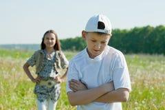 Amigos tristes del adolescente después de la pelea Imagen de archivo libre de regalías