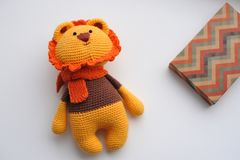 Amigurumi toy. Lion. Lion toy knitted in the technique of knitting amigurumi Stock Image