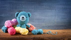 Amigurumi toys. On a wooden background stock photos