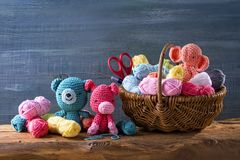 Amigurumi toys. On a wooden background stock photo