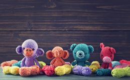 Amigurumi toys. On a wooden background Royalty Free Stock Photos