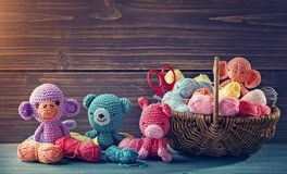 Amigurumi toys. On a wooden background stock images