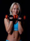 Amiling athlete holding weights Royalty Free Stock Photo