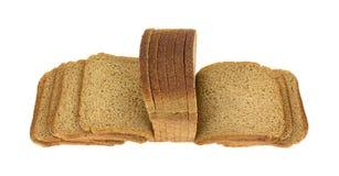 Amincissez l'angle supérieur éventé par pain découpé en tranches de blé Photo stock