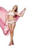 Amincissez la femme sexy dans les vêtements de bain d'isolement avec le tissu Image stock