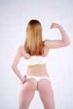Amincissez la femme sportive de forme physique dans le studio, vue arrière Image libre de droits