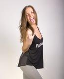 Amincissez la fille sexy dans un T-shirt noir et des guêtres Image libre de droits