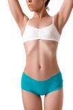 Amincissez le corps bronzé du ` s de femme D'isolement au-dessus du fond blanc Image stock