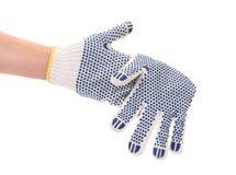 Amincissez le gant de travail avec le bouton bleu. Photo libre de droits