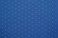 Amincissez le tissu tricoté de couleur bleue avec les points blonds Image libre de droits