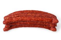 Amincissez les saucisses fumées d'isolement sur un fond blanc Image libre de droits