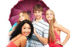 Amis avec le parapluie Photographie stock libre de droits
