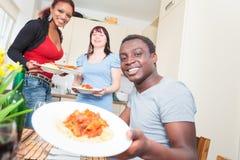 Amis ayant un dîner Images libres de droits