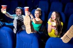 amis dans le cinéma Photographie stock