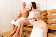 Amis dans le sauna Photographie stock