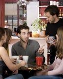 Amis dans un café Photos libres de droits