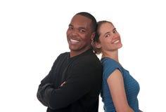 Amis de sourire heureux sur le fond blanc Image libre de droits