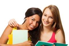 Amis heureux avec des livres Images libres de droits