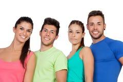 Amis heureux avec les vêtements de sport colorés Photo libre de droits