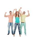 Amis heureux célébrant la victoire Images libres de droits