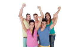Amis heureux célébrant la victoire Image libre de droits