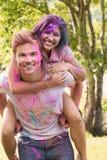 Amis heureux couverts en peinture de poudre Image stock