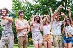 Amis heureux couverts en peinture de poudre Images libres de droits