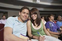 Amis heureux dans la salle de classe Photographie stock libre de droits