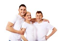 Amis heureux ensemble une femme et deux hommes Photo stock