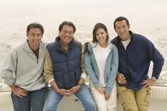 Amis heureux sur le yacht Photo libre de droits