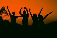Amis joyeux, silhouette Images libres de droits