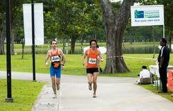 Amis pendant un marathon Images libres de droits