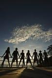 Amis sur le coucher du soleil Images stock