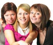 amis trois de sourire Photos libres de droits