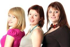 amis trois de sourire Image stock