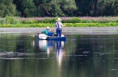 Amische Mann-Fischerei Stockfotos
