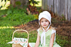 Amish. Little Amish girl gathering fresh chicken eggs Stock Image