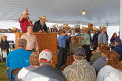 Amish Auctioneers Volunteer at the Annual Mud Sale Stock Photos