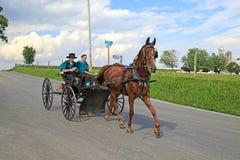 Amish barnvagnritt Arkivfoton