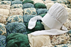 Amish Bonnet. On a biscuit quilt Royalty Free Stock Photography