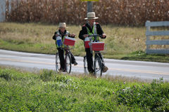 Amish Boys  Wearing Safety Vests and Riding Bikes Stock Photos