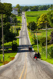 Amish Buggies Travel Rural Lancaster County Road Royalty Free Stock Photography