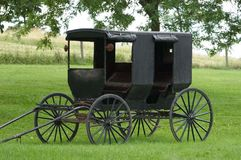 Amish Buggy. Sitting in field, unhitched.  Larger model for family use Stock Images