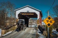 Amish buggy exits Weavers Mill Bridge Stock Photos