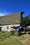 Amish buggy in front of old barn roof being repaired Royalty Free Stock Photography